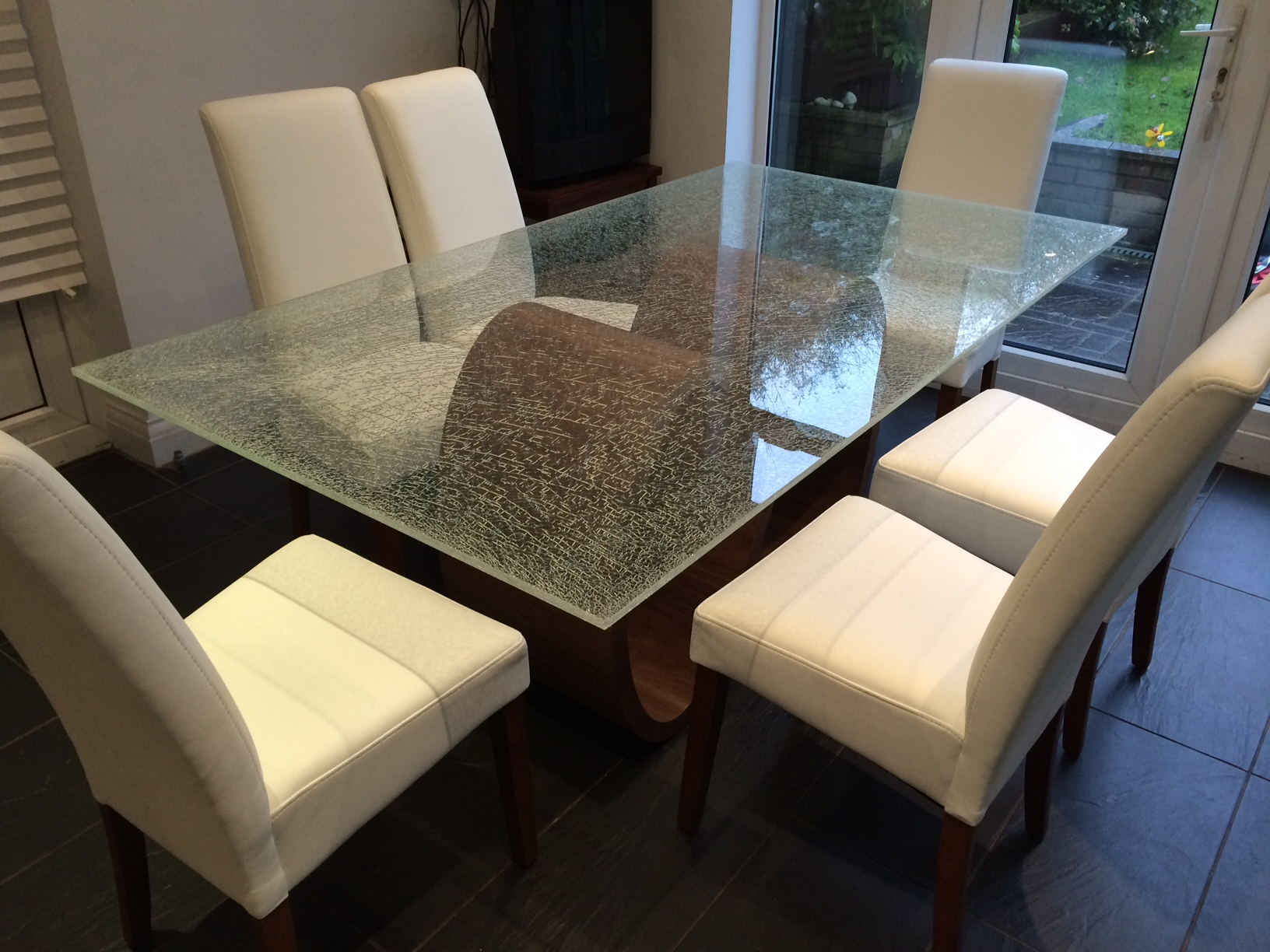Installation gallery for Cracked glass dining table